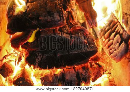 Hot Burning Wood In A Stone Oven