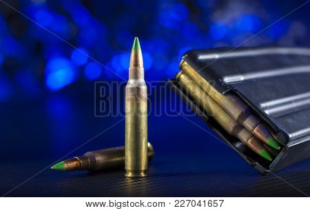 M855 Ammunition For An Ar-15 With Magazine On Blue Background