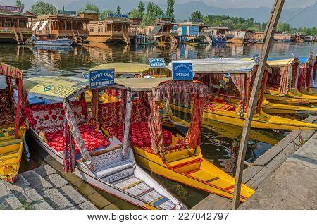 Srinagar, India - Julay 30, 2017: Typical Taxi Boats On The Dal Lake, Called Shikara, Waiting Client