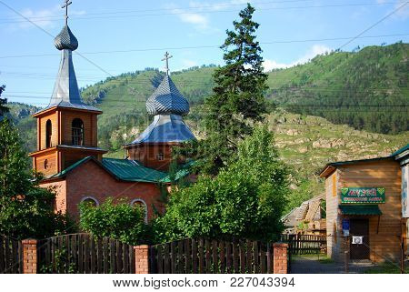 Wooden Chirch And Trees In The Mountains