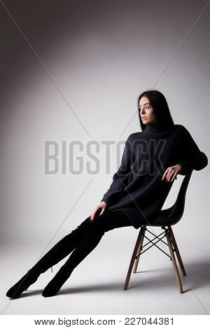 High Fashion Portrait Of Young Elegant Woman Sittung On Chair Black Clothes Isolated On White Backgr