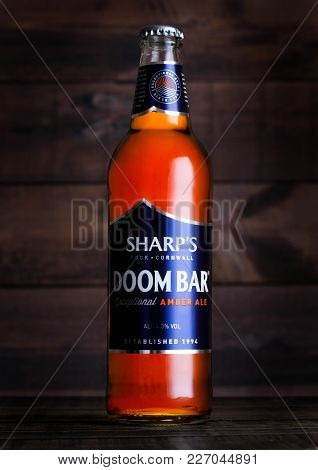 London, Uk - February 14, 2018: Cold Bottle Of Sharp's Doom Bar Amber Ale On Wood.
