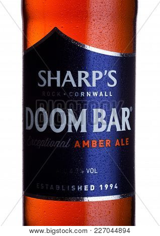 London, Uk - February 14, 2018: Cold Bottle Label Of Sharp's Doom Bar Amber Ale On White.