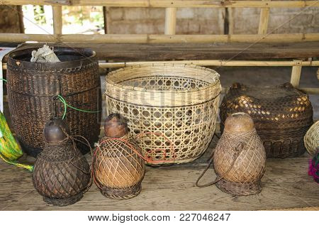 Wicker Baskets And Jugs For Water On A Wooden Table