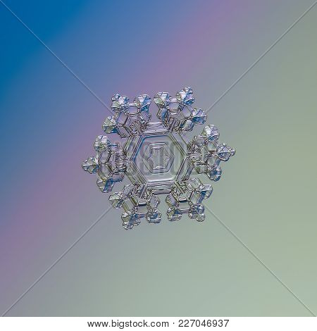 Transparent Snowflake Glittering On Smooth Gradient Background. Macro Photo Of Real Snow Crystal: Be