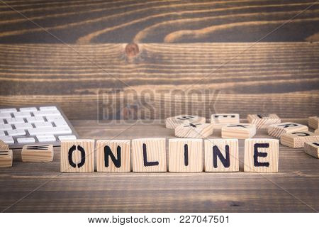 Online. Wooden Letters On The Office Desk, Informative And Communication Background.