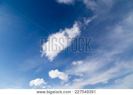 Beautiful Clouds On A Blue Sky As Background .