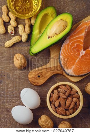 Ketogenic Low Carbs Diet Concept. Healthy Eating And Dieting With Salmon Fish, Avocado, Eggs And Nut
