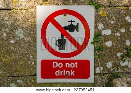 Sign & Symbol: Do Not Drink, Seen In Tyneham Village, Jurassic Coast, Dorset, Uk
