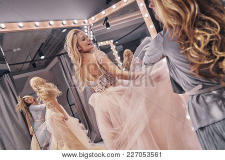 Big Moment Is Coming.  Reflection Of Young Woman Adjusting A Wedding Dress On Attractive Bride While
