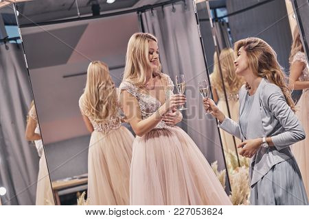 To The Bride! Attractive Young Women Toasting Each Other And Smiling While Standing In The Fitting R