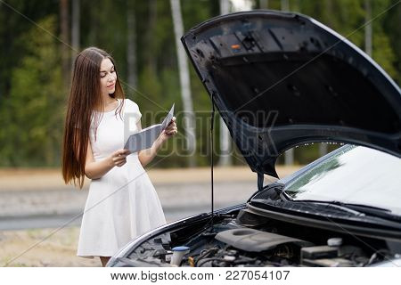 Woman Near Broken Car With Opened Hood