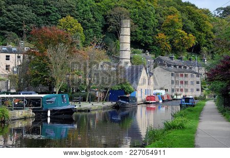 The Canal And Marina In Hebden Bridge With Boats On The Water, Towpath And Surrounding Hillside Tree