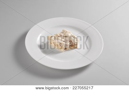 Round Dish With A Piece Of Nougat With Almonds