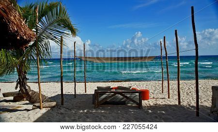 Chairs In The Shade On White Beaches In Cancun Mexico
