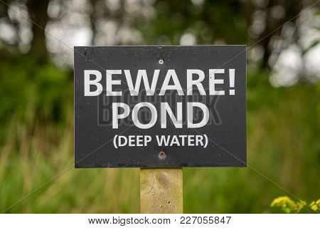 Sign: Beware! Pond (deep Water), Seen Near Bawdsey, Suffolk, England, Uk