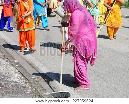Sikh Religion Women During The Ceremony Along The Streets Of The City While Sweeping The Road