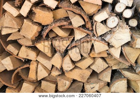 Natural Wooden Background Close Up Of Chopped Firewood Firewood Stacked And Prepared For Winter
