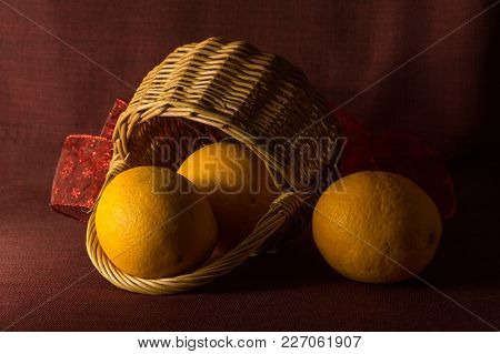 Vintage Christmas Composition With Wooden Basket And Food Fruits