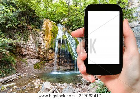 Travel Concept - Tourist Photographs Ulu-uzen River With Djur-djur Waterfall In Haphal Gorge Of Habh