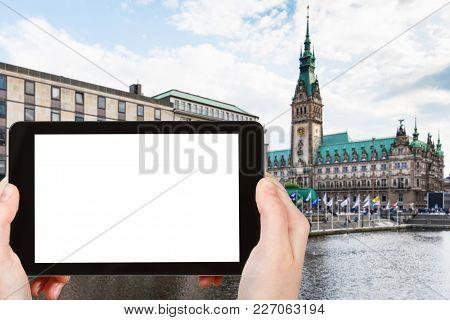 Travel Concept - Tourist Photographs Quay Of Binnenalster (inner Alster Lake) And Hamburger Rathaus