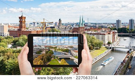 Travel Concept - Tourist Photographs Berlin City With Spree River On Tablet