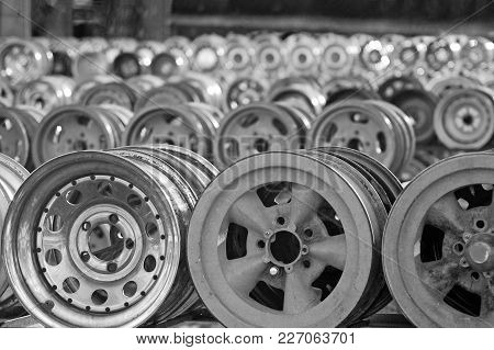 Automobile Wheels On Display In A Hubcap Graveyard