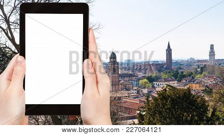 Travel Concept - Tourist Photographs Verona City Skyline In Spring On Tablet With Cut Out Screen For