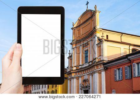 Travel Concept - Tourist Photographs Chiesa Di Ognissanti In Mantua City In Italy In Spring On Table