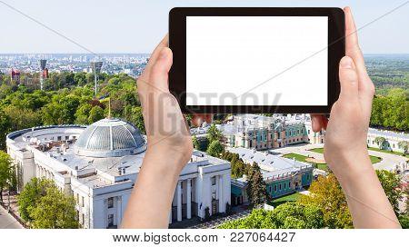 Travel Concept - Tourist Photographs Verkhovna Rada Building (supreme Council Of Ukraine) And Mariyi