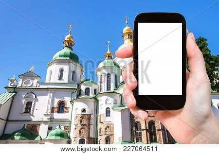 Travel Concept - Tourist Photographs Saint Sophia (holy Sophia) Cathedral In Kiev City In Ukraine On