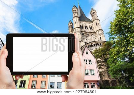 Travel Concept - Tourist Photographs Medieval Houses On Fischmarkt Area And Great St Martin Church I