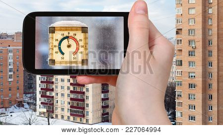 Travel Concept - Tourist Photographs Outdoor Thermometer In Sunny Winter Day In Moscow City On Smart