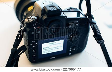 Paris, France - Jan 31, 2018: Display Of Nikon Dslr Camera Professional Updating Firmware With Messa