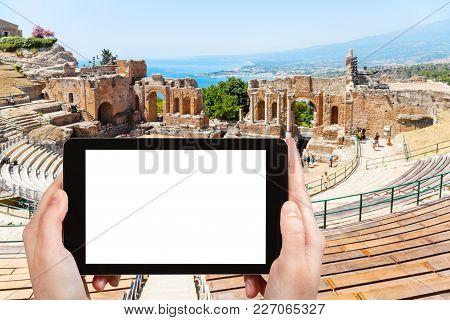 Travel Concept - Tourist Photographs Ancient Greek Theater (teatro Greco, Teatro Antico Di Taormina)