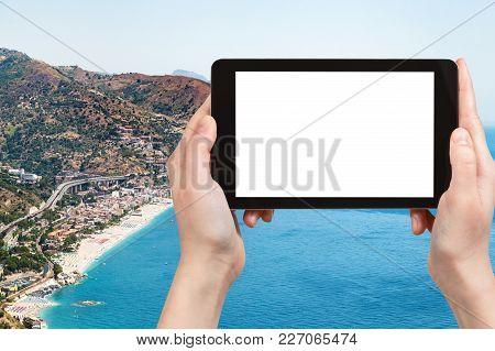 Travel Concept - Tourist Photographs Letojanni Resort Village On Beach Of Ionian Sea Near Taormina C