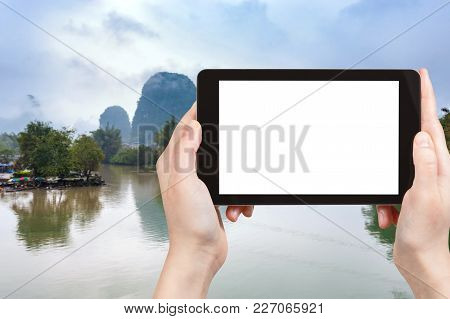 Travel Concept - Tourist Photographs Calm Surface Yulong And Jinbao Rivers And Karst Peaks In Yangsh