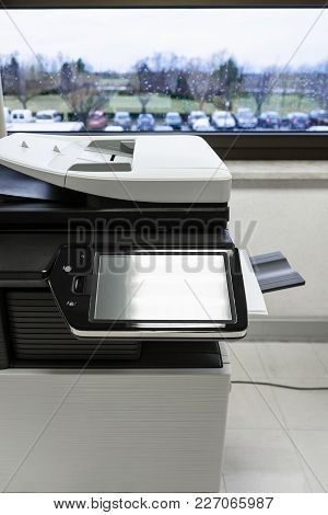 Big Copier With Touchscreen Display In Office Hall Near Window In Autumn Rainy Day