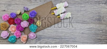 Present, Surprise, Love Concepts. Marshmallow Candies In The Envelope Decorated With Multi-colored F