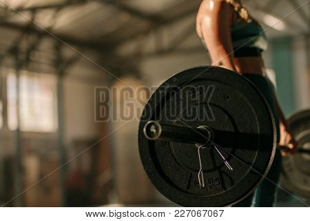Heavy Weights Exercises Performed By Female Athlete