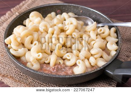 Pasta In Ceramic Form With Meat Pate In A Frying Pan On Background Table