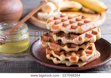 Homemade Belgian Waffles With With Bananas And Honey