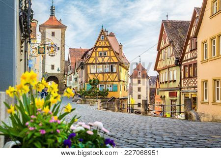Classic View Of The Medieval Town Of Rothenburg Ob Der Tauber With Blooming Flowers On A Beautiful S