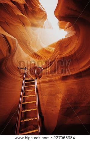 Beautiful View Of Amazing Sandstone Formations With A Ladder Leading Toward A Magic Light Beam In Fa