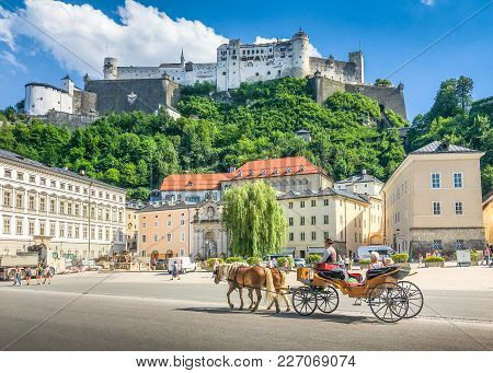 Beautiful Panoramic View Of The Historic City Of Salzburg With Traditonal Horse-drawn Fiaker Carriag