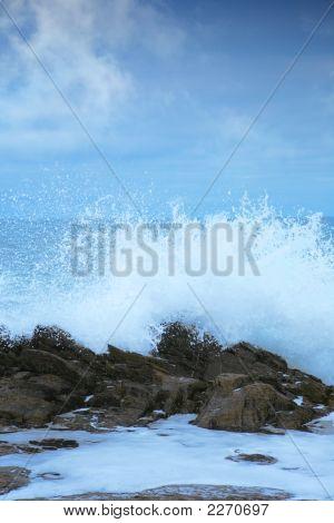 Waves Splash Agains Rocks On The  Coast