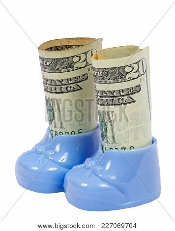 Vertical shot of a pair of blue plastic baby booties which each holds a roll of money.  One shows a twenty dollar bill on the outside.  White background.