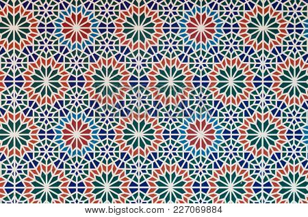 Arabic Style Pattern Multi Color Pieces Of Mosaics Form White Line Pattern Between Them.