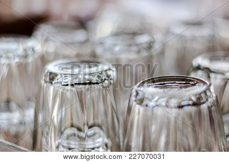 Selected Focus Close Up On Bottom Of Empty Transparent Drinking Glasses Placed Upside Down In Group
