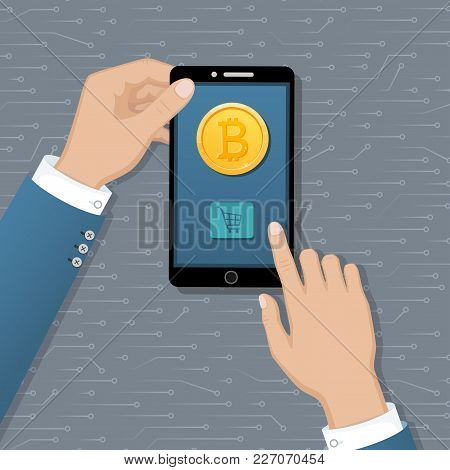 Hands Holding Mobile Phone With Gold Coin Bitcoin And Button Buy. Payment Service International Tran